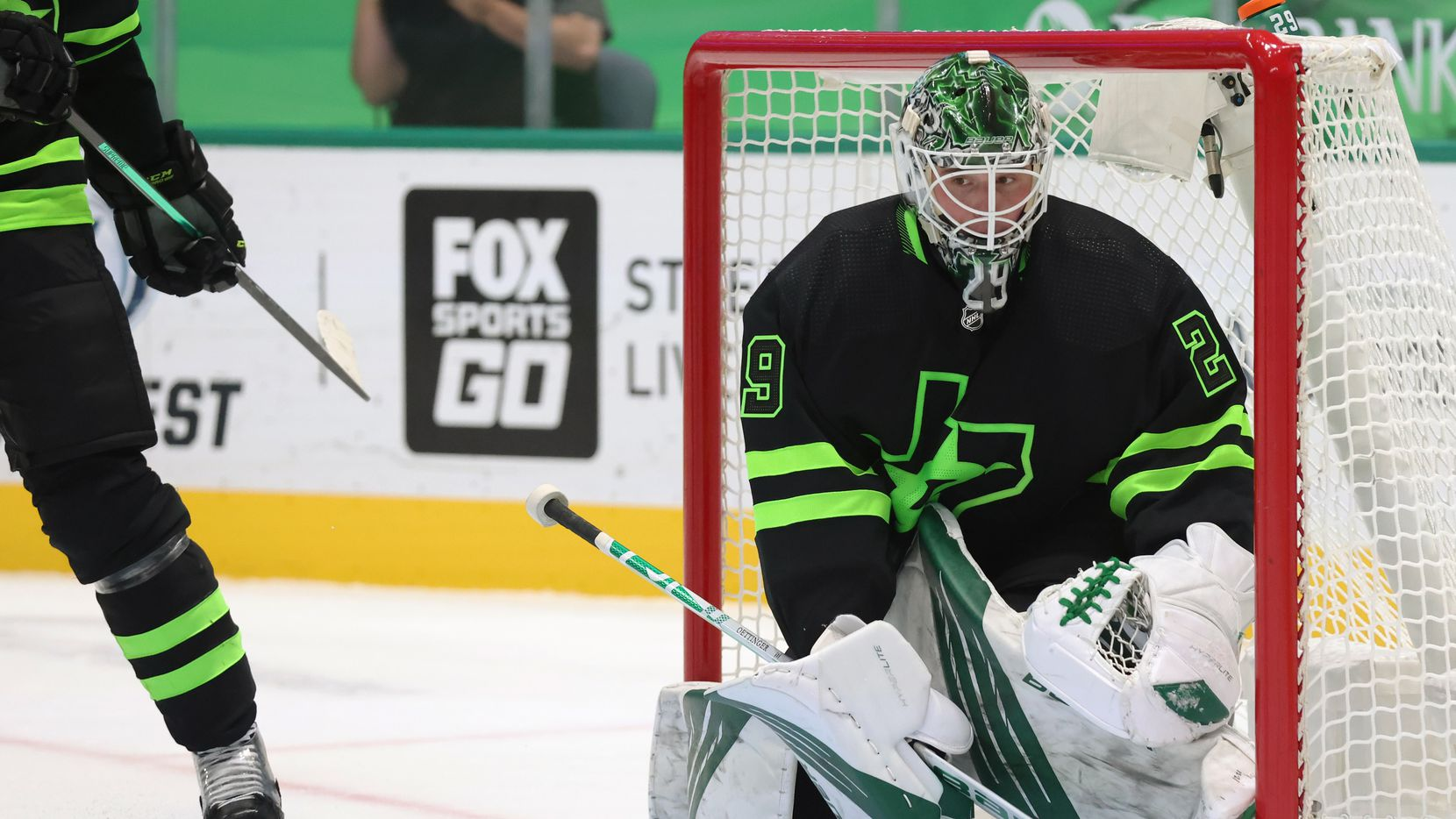 Dallas Stars goaltender Jake Oettinger (29) watches as the puck rolls in a game against the Detroit Red Wings during the second period of play at American Airlines Center on Thursday, January 28, 2021in Dallas.