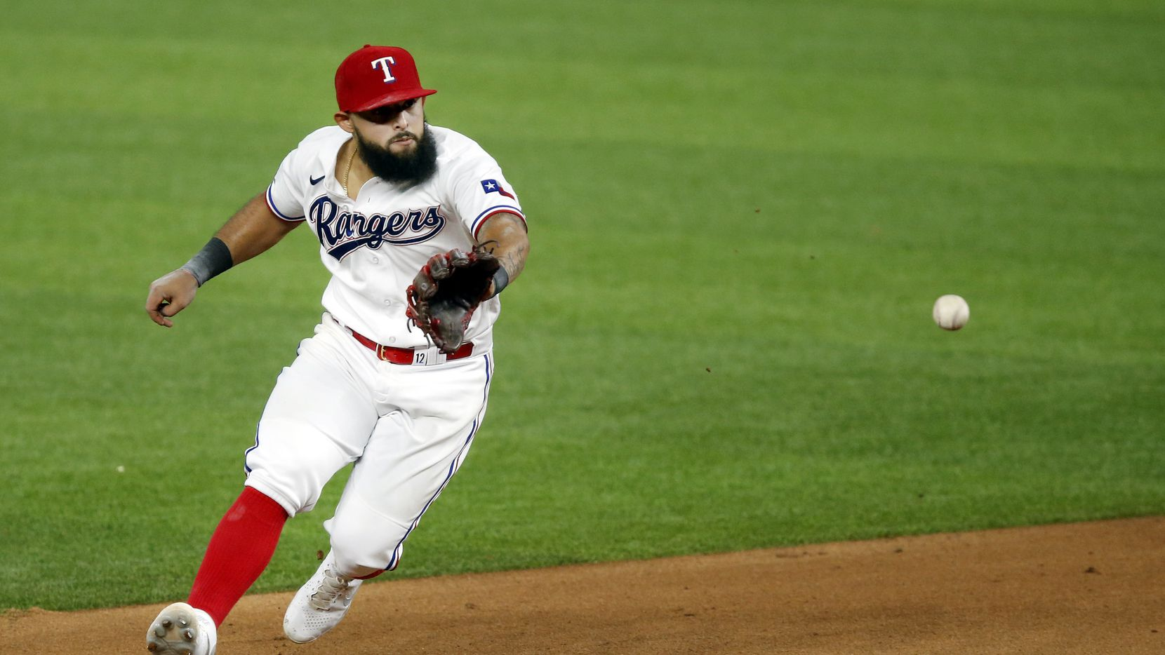Texas Rangers second baseman Rougned Odor (12) fields a ball hit by Seattle Mariners Austin Nola and makes the out at first during the eighth inning at Globe Life Field in Arlington, Tuesday, August 11, 2020.