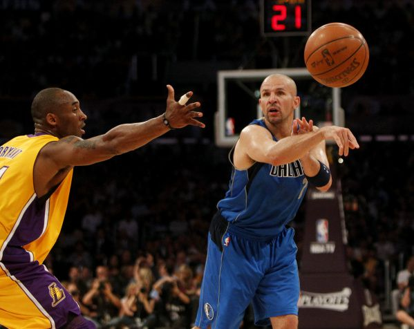 Dallas' Jason Kidd (right) passes against Los Angeles' Kobe Bryant during Game 2 of their Western Conference playoff series on May 4, 2011.