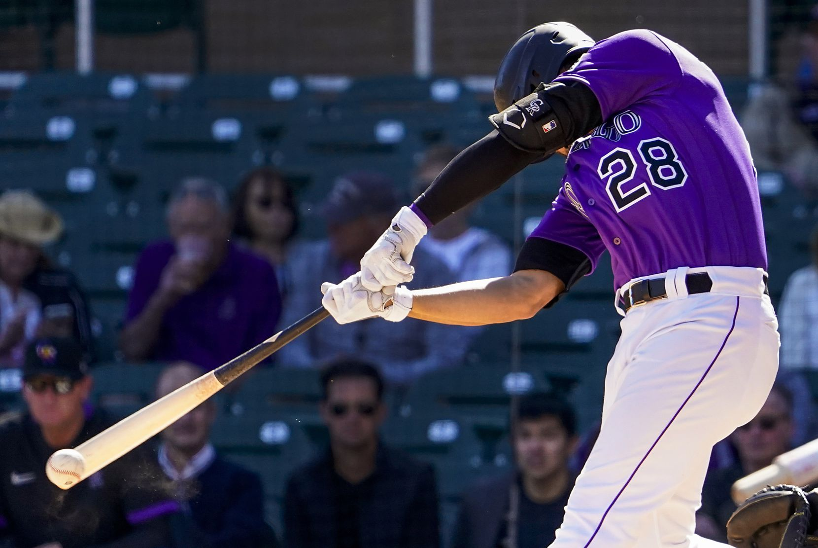 Colorado Rockies third baseman Nolan Arenado bats during the third inning of a spring training game against the Texas Rangers at Salt River Fields at Talking Stick on Wednesday, Feb. 26, 2020, in Scottsdale, Ariz.