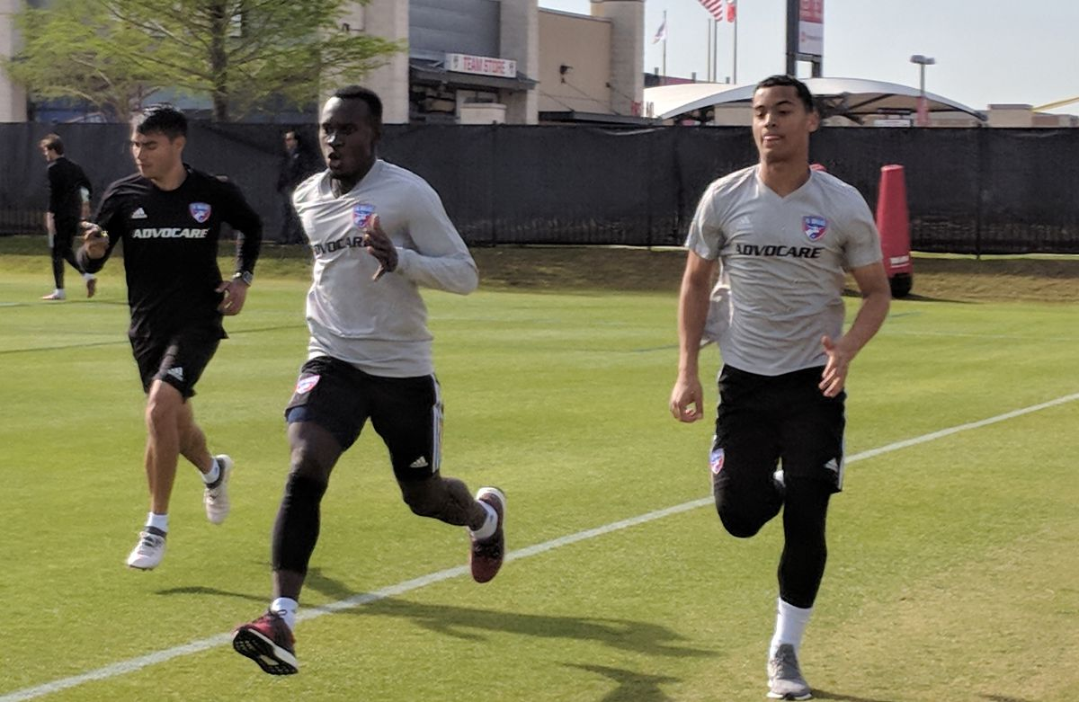 Vander Salas (left), FC Dallas' Assistant Athletic Performance Coach, works Francis Atuahene (middle) and Brandon Servania (right) during FC Dallas training. (4-11-18)