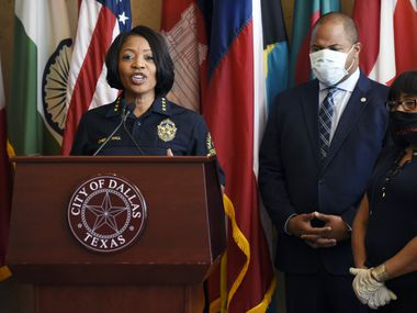 Dallas Chief of Police Renee Hall, left, and Dallas Mayor Eric Johnson, right, conduct a press conference addressing the Friday night protests in honor of Mr. George Floyd, Saturday, May 30, 2020. Mayor Johnson and Chief Hall are calling for peace and calm for this weekend's protests. Ben Torres/Special Contributor