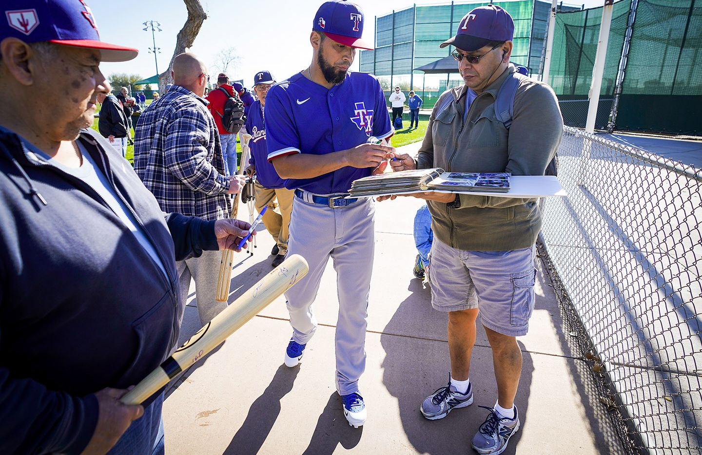 Texas Rangers catcher Robinson Chirinos signs autographs for fans before the first spring training workout for pitchers and catchers at the team's training facility on Wednesday, Feb. 12, 2020, in Surprise, Ariz.