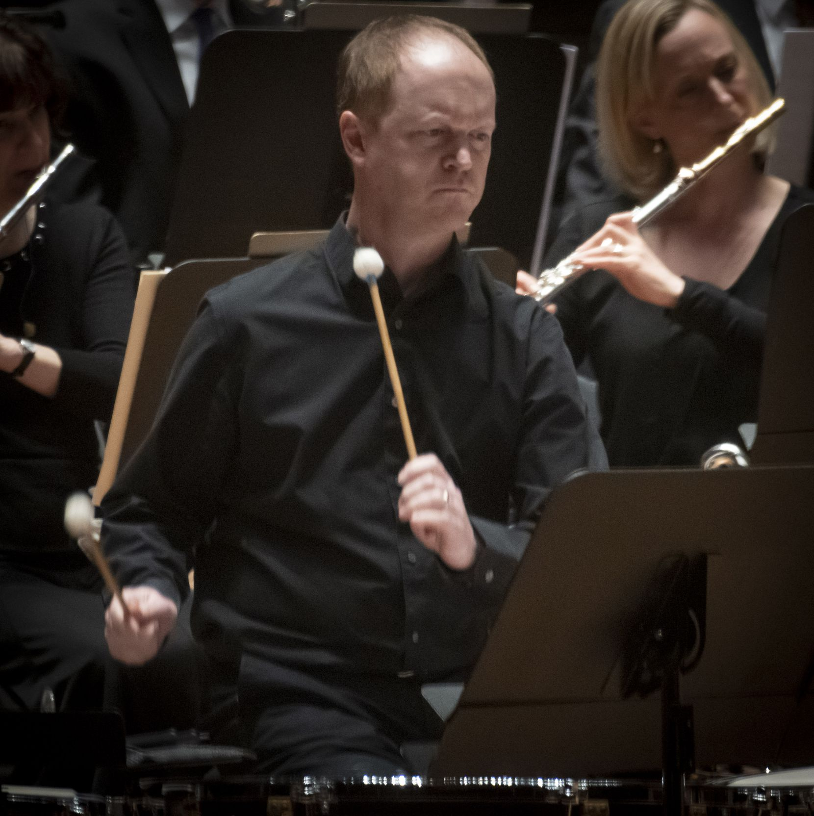 """Dallas Symphony Orchestra principal timpanist Brian Jones performs the world premiere of Steven Mackey's timpani concerto """"A Different Drummer"""" with the orchestra and principal guest conductor Gemma New at the Meyerson Symphony Center on November 8, 2019."""