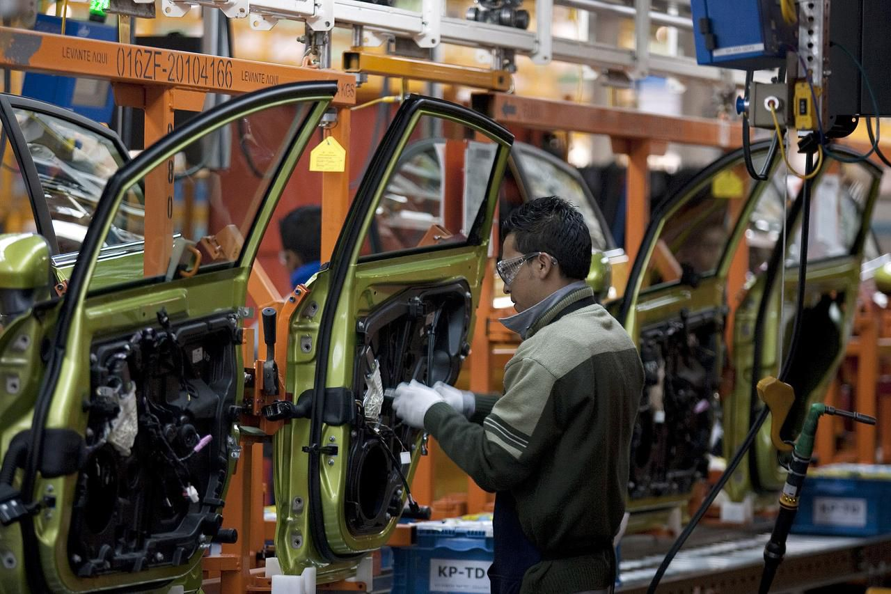An employee works on the assembly line producing the new Ford Fiesta car, at the Ford Motor Co. plant in Cuautitlan Izcalli, Mexico in May 2010. Since NAFTA passed 21 years ago, Mexico has become a world-class auto manufacturer. which has improved prospects for the entire industry in North America.