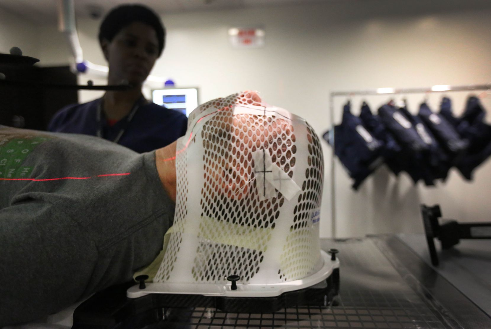 Weiss gets prepped for his radiation treatment at the hospital. (Louis DeLuca/Staff Photographer)
