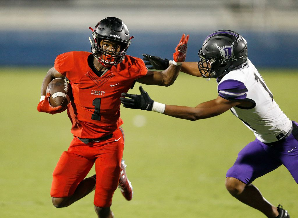 Liberty's Geomaih Lewis (1) attempts to break away from Independence's Caleb Ellis (14) during the second half of play at Toyota Stadium in Frisco, Texas on Thursday, September 26, 2019. (Vernon Bryant/The Dallas Morning News)