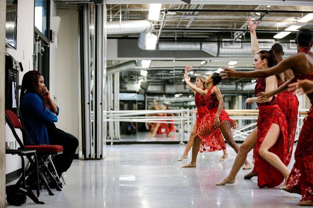 Artistic director Bridget L. Moore (left) watches as her dance company rehearses at Booker T. Washington High School for the Performing and Visual Arts.