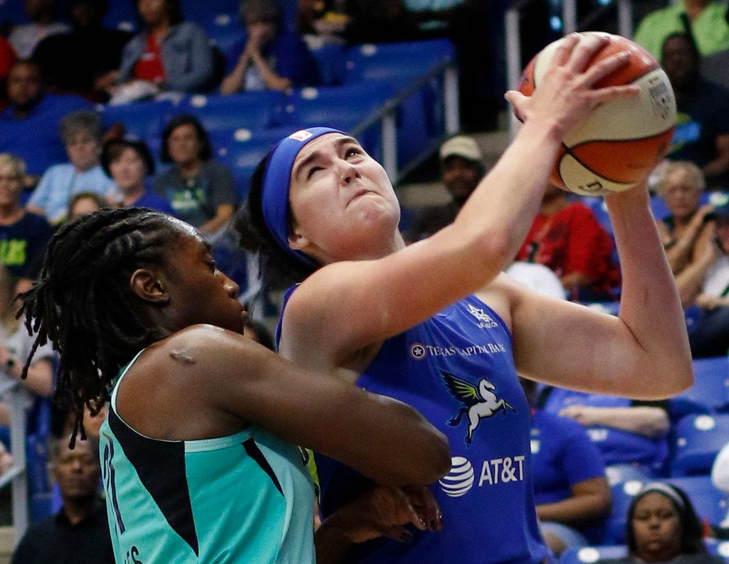 Dallas Wings forward Megan Gustafson (13) drives to the basket past the defense of New York Liberty center Tina Charles (31) during first half action. The two teams played their WNBA game at College Park Center in Arlington on August 1, 2019. (Steve Hamm/ Special Contributor)