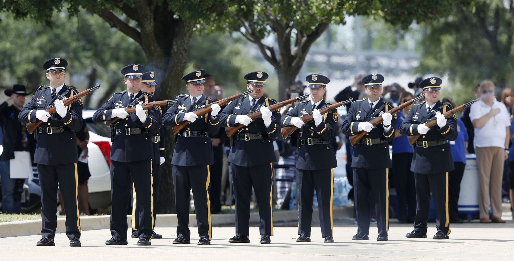 21 gun salute during a memorial service for DART Officer Brent Thompson at The Potter's House in Dallas on Wednesday, July 13, 2016. Thompson was one of five officers killed last week when a gunman opened fire during a Black Lives Matter rally in downtown Dallas.