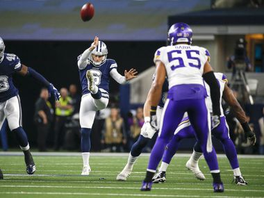 Dallas Cowboys punter Chris Jones (6) sends the ball airborne during the first quarter of an NFL football game between the Dallas Cowboys and the Minnesota Vikings at AT&T Stadium in Arlington, Texas, on Sunday, Nov. 10, 2019.