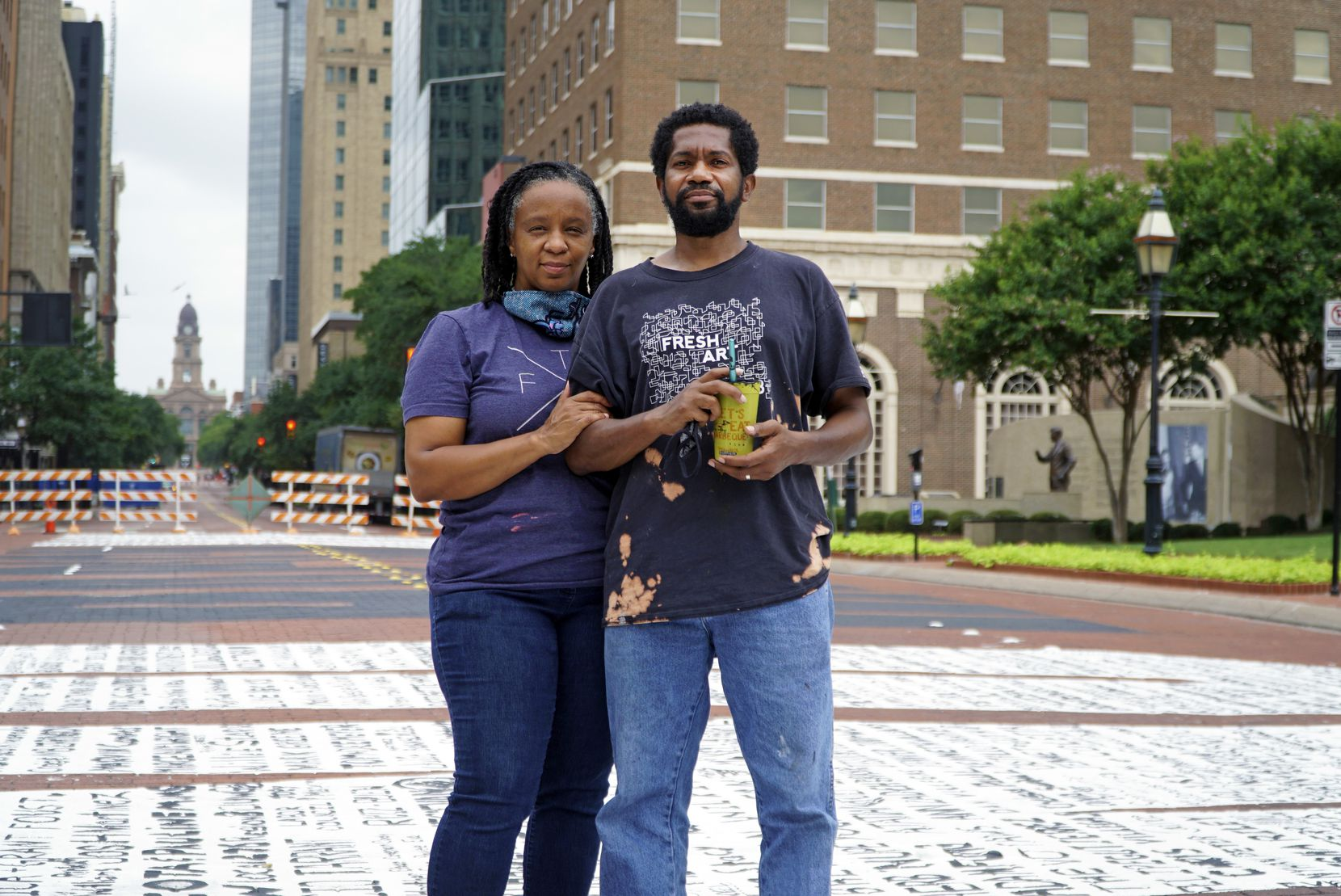 "Letitia and Sedrick Huckaby on the ""End Racism Now"" mural in downtown Fort Worth on Tuesday, June 30, 2020. The couple was the creators of the mural. (Lawrence Jenkins/Special Contributor)"