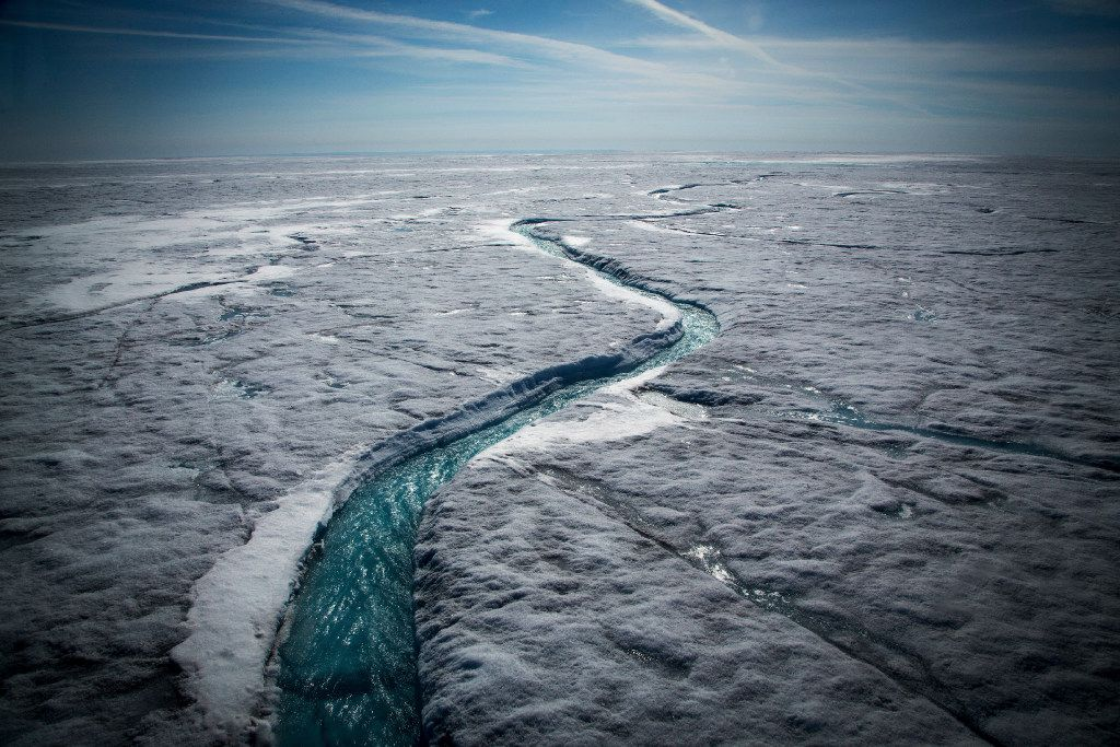Meltwater flows along a supraglacial river on the Greenland ice sheet, one of the biggest and fastest-melting chunks of ice on Earth.  (Josh Haner/The New York Times)