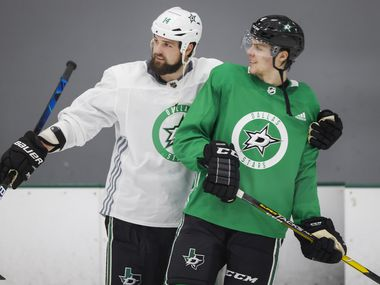 Dallas Stars left wing Jamie Benn (14) hugs defenseman Miro Heiskanen (4) during a training camp practice at the Comerica Center on Wednesday, Jan. 6, 2021, in Frisco.