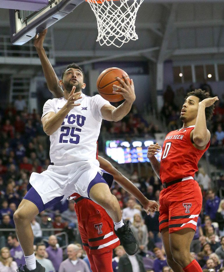 TCU Horned Frogs guard Alex Robinson (25) goes up for two against Texas Tech Red Raiders forward Tariq Owens (11) and guard Kyler Edwards (0) during an NCAA basketball game at Schollmaier Arena Fort Worth, Texas on Saturday, March 2, 2019. (Shaban Athuman/The Dallas Morning News)