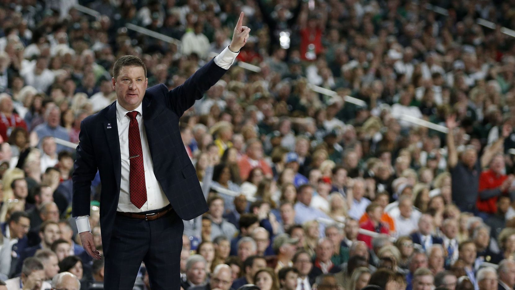Texas Tech Red Raiders head coach Chris Beard communicates to his players in a game against the Michigan State Spartans during the second half of play in the semifinals of the Final Four NCAA college basketball tournament at U.S. Bank Stadium in Minneapolis on Saturday, April 6, 2019. Texas Tech Red Raiders defeated the Michigan State Spartans 61-51.