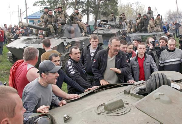 Pro-Russian activists blocked Ukrainian men riding on armored personnel carriers in Kramatorsk on Wednesday. Ukraine has accused Russia of fomenting the unrest.