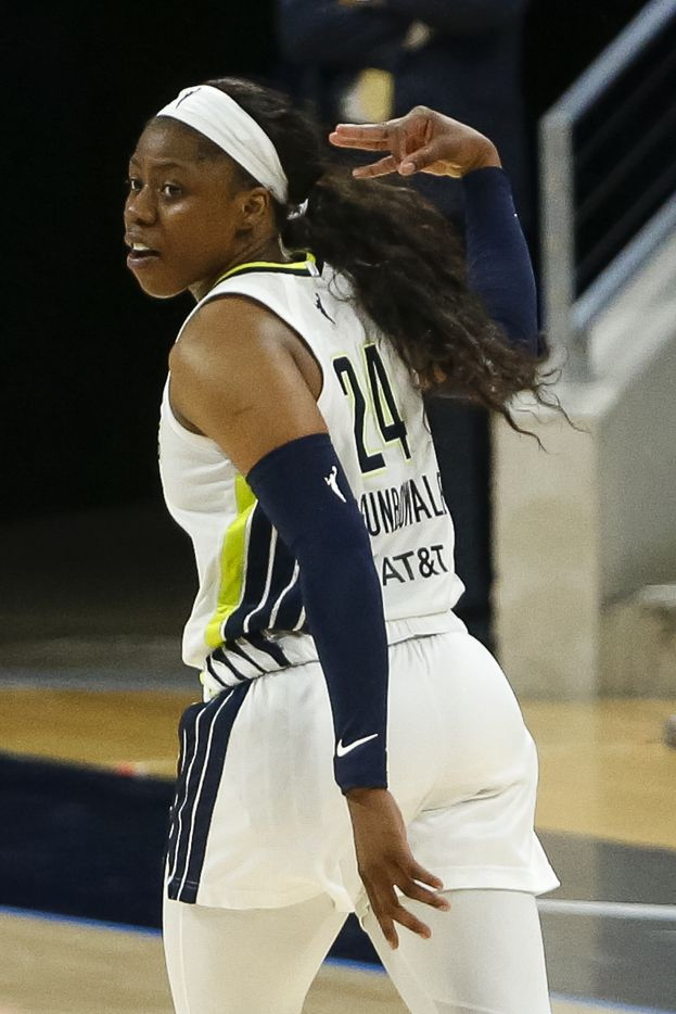 Dallas Wings guard Arike Ogunbowale (24) holds up three fingers after making a three-point shot during the fourth quarter against the Washington Mystics at College Park Center on Saturday, June 26, 2021, in Arlington. (Elias Valverde II/The Dallas Morning News)