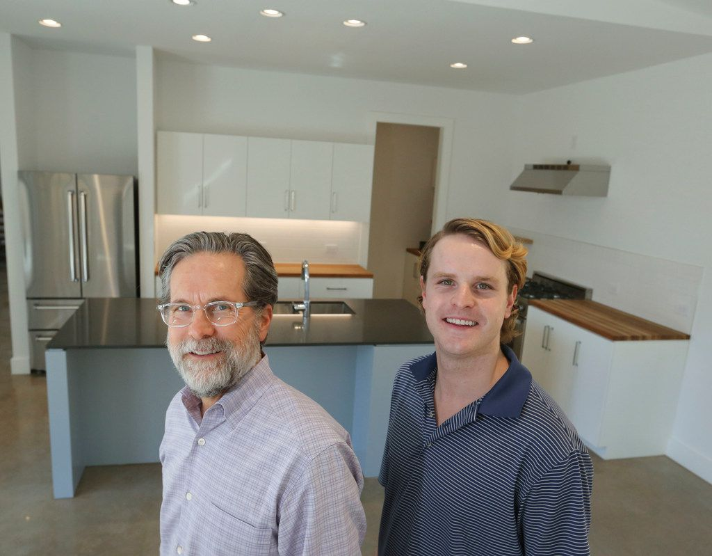 Kyle Fagin, left, and son Connor Fagin, owners of Fagin Partners, in the kitchen of the recently finished passive house in Dallas.