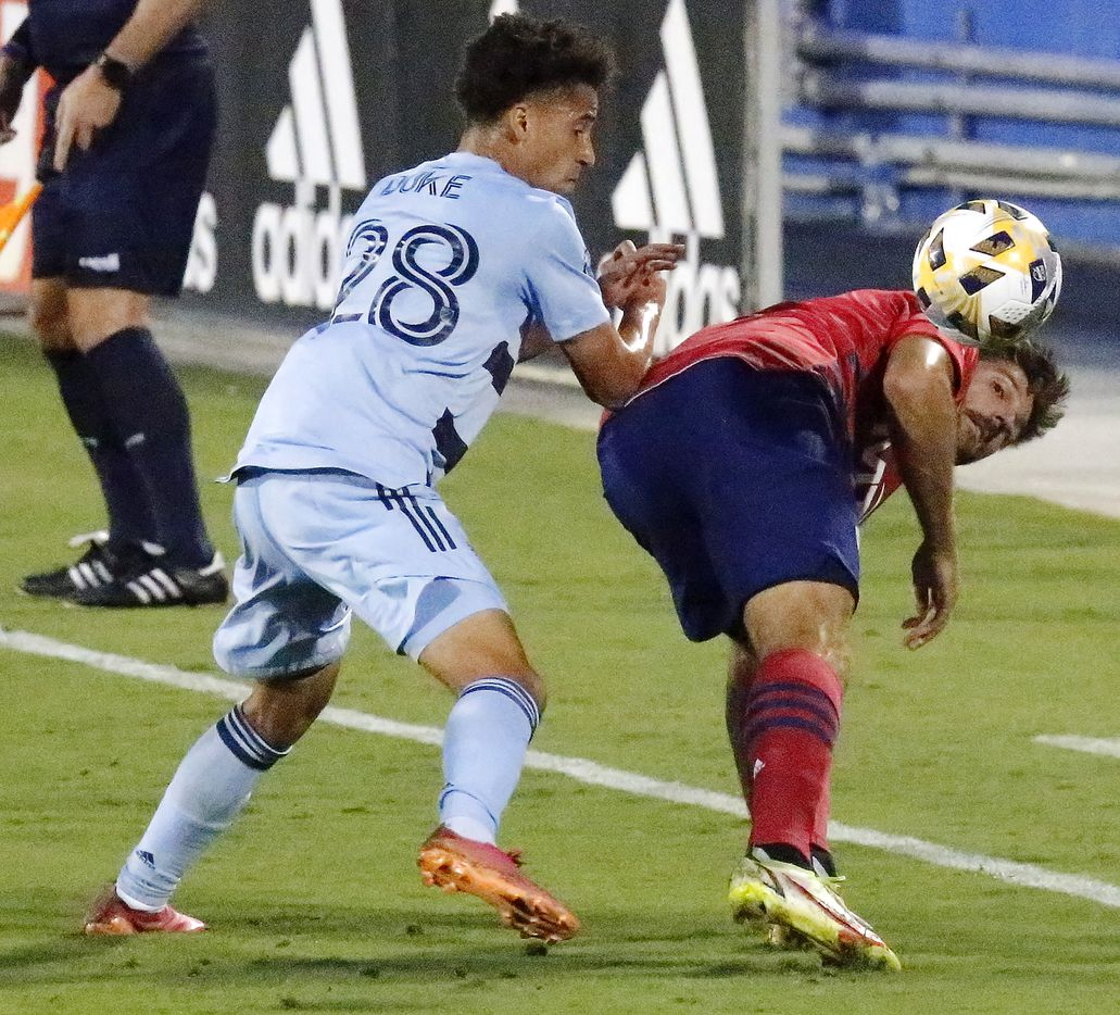 FC Dallas midfielder Ryan Hollingshead (12) looks backward for the ball before using his heel to make a pass while Sporting Kansas City midfielder Cameron Duke (28) defends during the first half as FC Dallas hosted Sporting Kansas City at Toyota Stadium in Frisco on Wednesday, September 29, 2021. (Stewart F. House/Special Contributor)