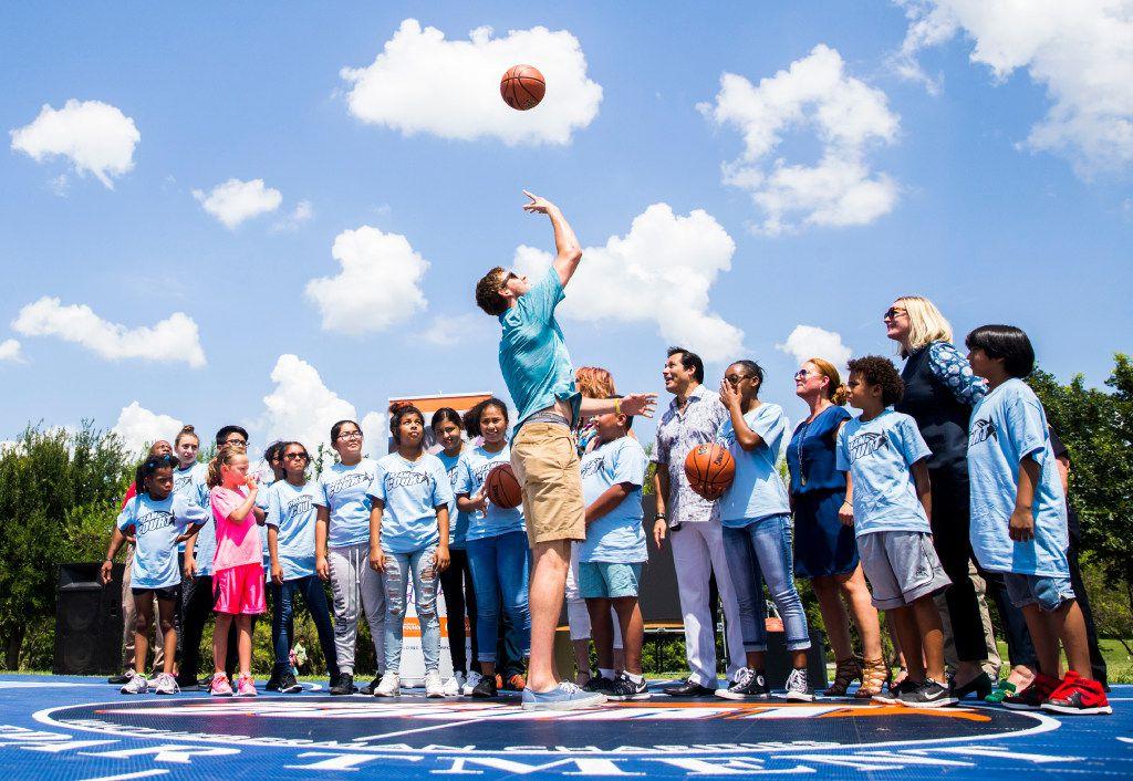 T.J. Cline, son of women's basketball legend Nancy Lieberman, shoots a circus shot at the Kiest Park Dream Courts in Dallas.