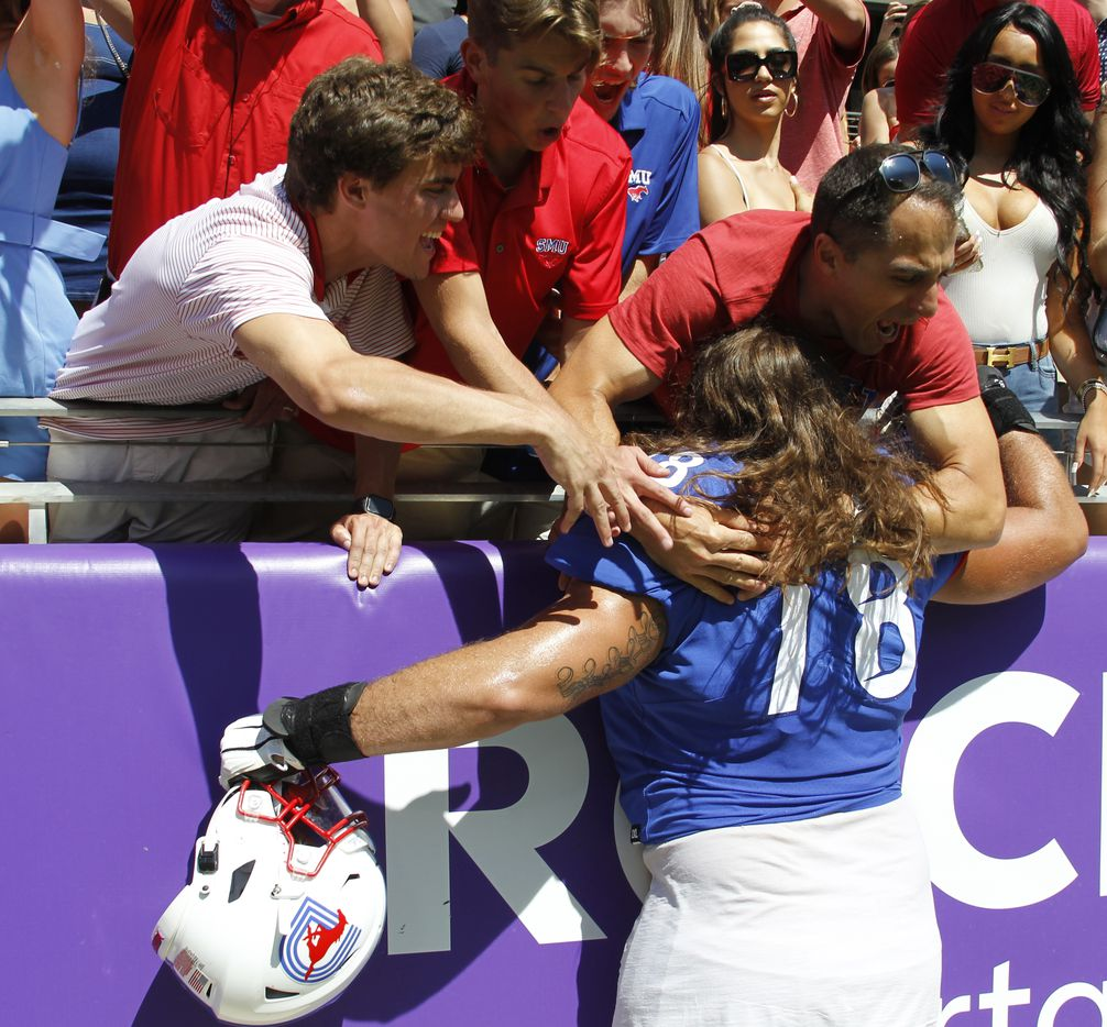 SMU offensive lineman Beau Morris (78) receives a big hugs from fans following the Mustangs' 42-34 victory over TCU. The two teams played their NCAA football game at Amon G. Carter Stadium on the campus of TCU in Fort Worth on September 25, 2021. (Steve Hamm/ Special Contributor)
