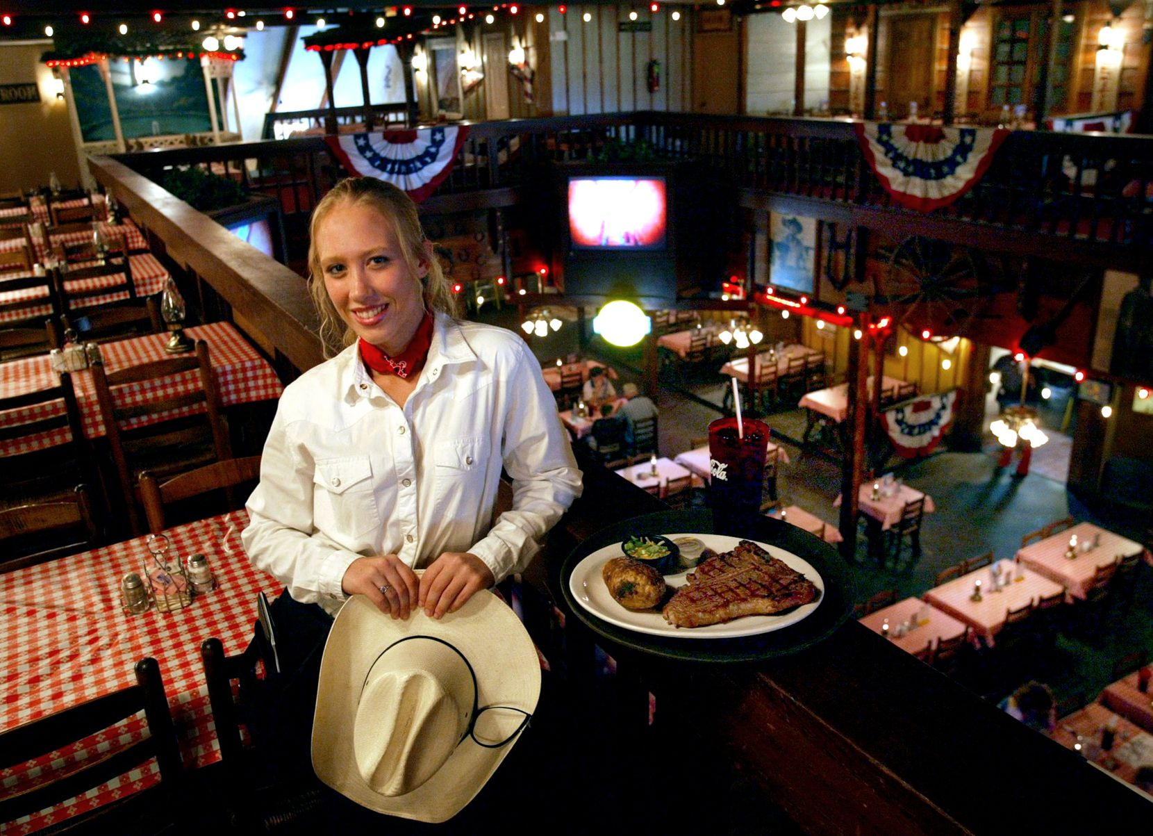 Waitress Sarah Beringer displayed the Cowboy, a 20-ounce steak, at the Trail Dust Steak House in Mesquite in this 2003 file photo.