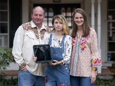 """Mack and Elizabeth Simpson pose with their daughter Carson Simpson, an eighth-grader at West Junior High School, outside their home, Friday, February 26, 2021 in Richardson, Texas. The Simpsons are choosing to not have Carson take the STAAR test this spring due to COVID concerns.  Mack, who is immunocompromised, called the prospect of Carson taking the test in person """"a bridge too far."""" (Jeffrey McWhorter/Special Contributor)"""