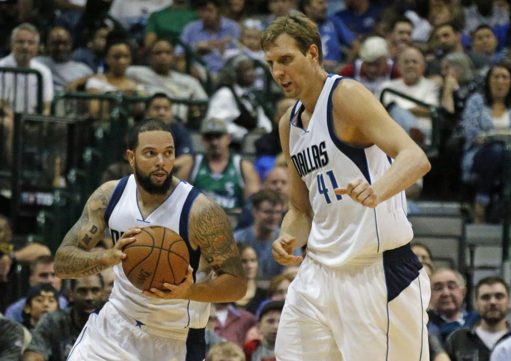 Dallas Mavericks guard Deron Williams (8) and forward Dirk Nowitzki (41) are pictured during the Houston Rockets vs. the Dallas Mavericks NBA basketball preseason game at the American Airlines Center in Dallas on Wednesday, October 19, 2016. (Louis DeLuca/The Dallas Morning News)