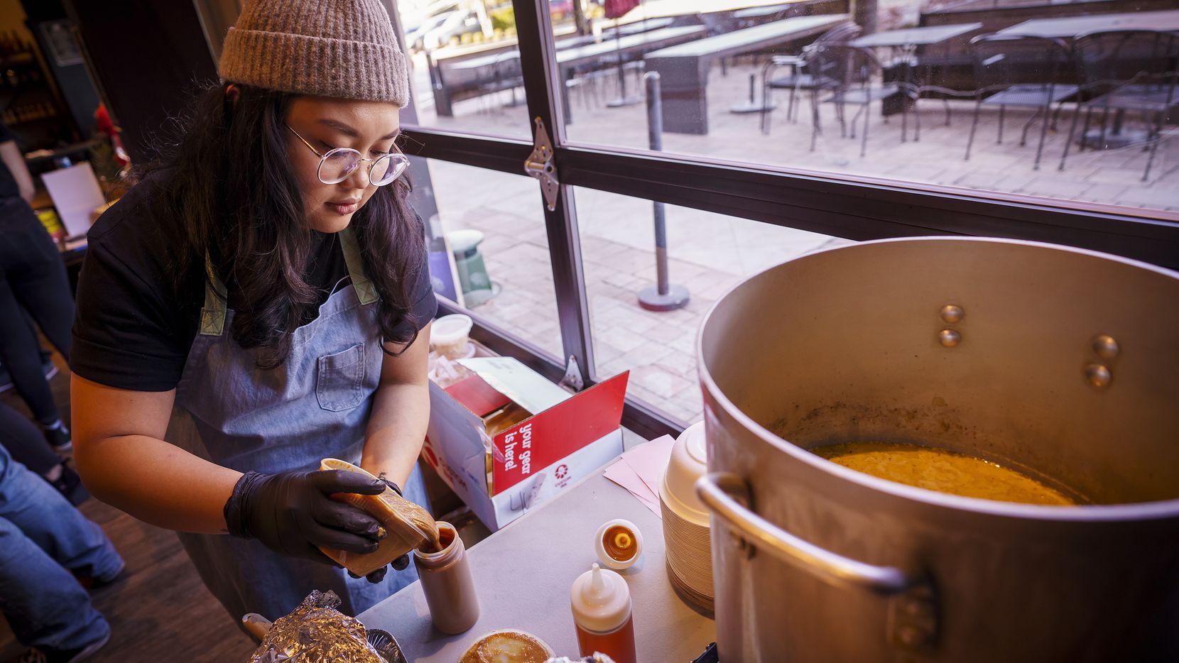 Chef Sarah Ranola preps sauces at a pop-up location of Hella Lumpia.