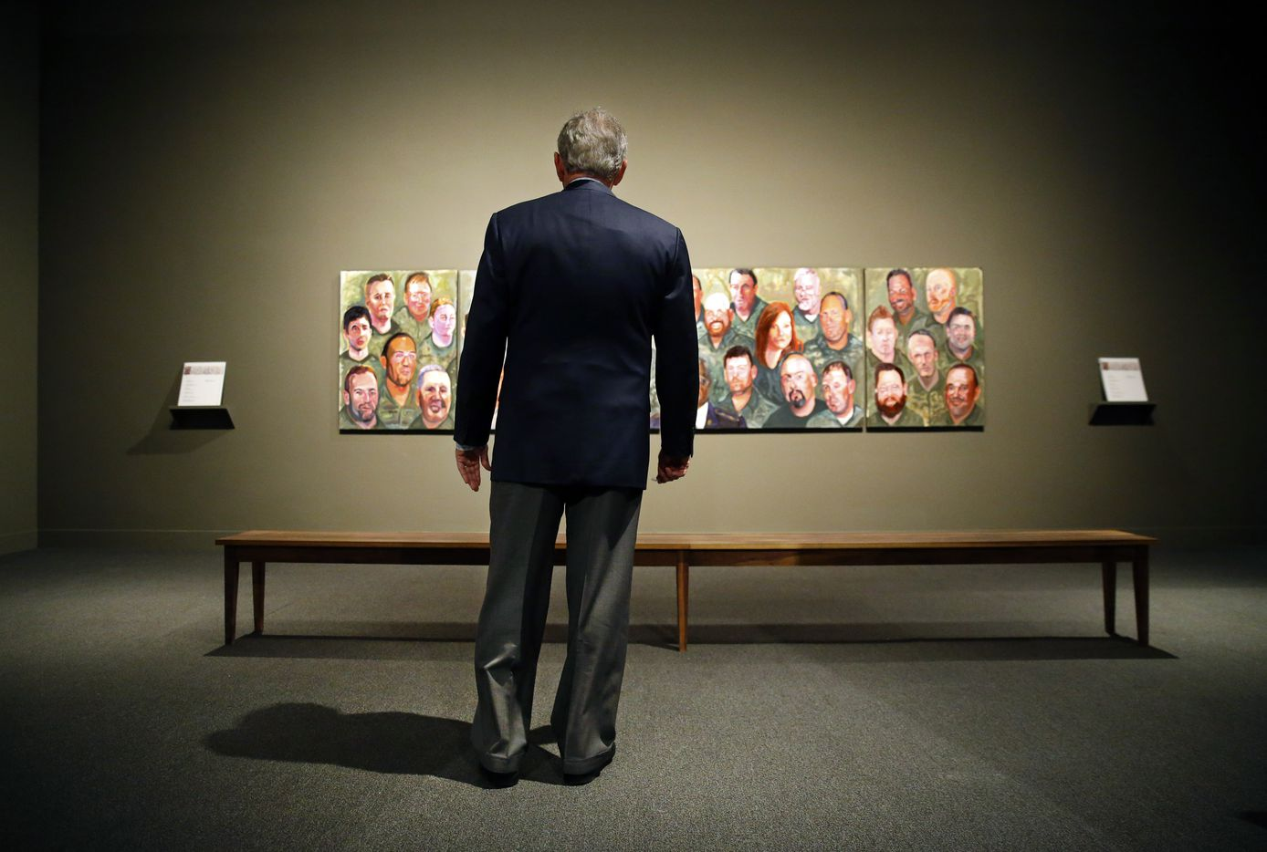 "Former President George W. Bush takes his first look at the ""Portraits of Courage: A Commander In Chief 's Tribute To America's Warriors"" exhibit at the George W. Bush Presidential Center in University Park. There are 64 full-color oil portraits and a four-panel mural (pictured here) of  U.S. military service members who've served with honor since 9/11 and whom Bush has come to know personally over the years. The exhibit opened March 2 and runs through Oct. 1."