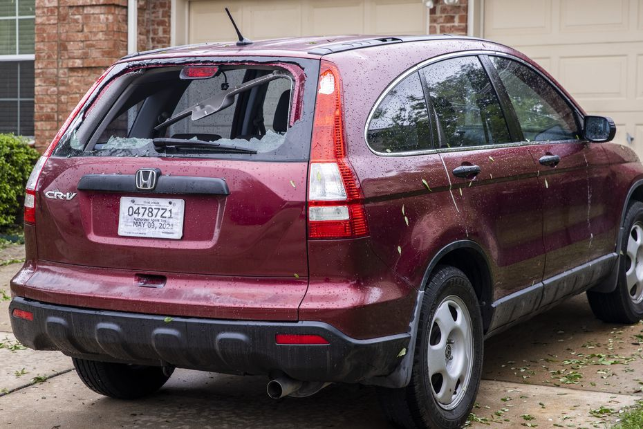 A vehicle sustained significant window damage in a severe hailstorm overnight in Keller, Texas, on Thursday, April 29, 2021. Areas of North Texas experienced severe storms, some with reported baseball-sized hail. (Lynda M. González/The Dallas Morning News)