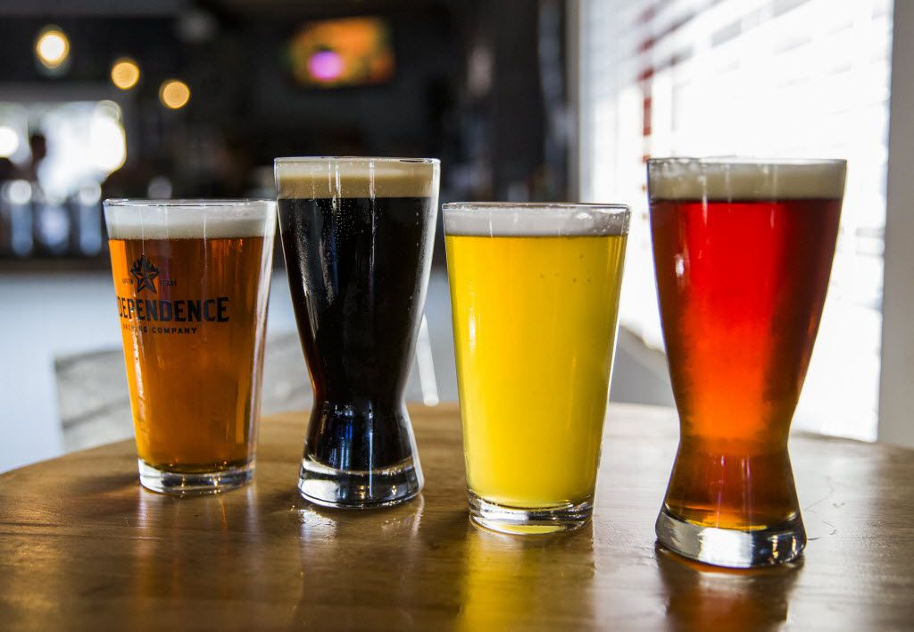 From left, Mosaic IPA by Community Beer Company, The Temptress by Lakewood Brewing Company, Bombshell Blonde Ale by Southern Star Brewing Company and Velvet Hammer by Peticolas Brewing Company are four of the beers on tap at FM Smokehouse on Wednesday, September 30, 2015 in Irving.
