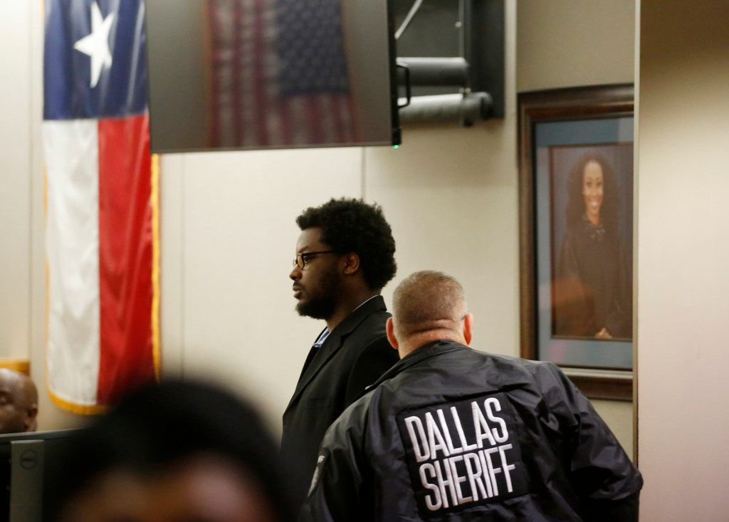 Thomas Johnson makes his way back to his seat after a break during the second day of his murder trial at Frank Crowley Courts Building in Dallas on Tuesday, April 30, 2019. Johnson is accused of killing Dave Stevens, 53, who was on his daily run along White Rock Creek Trail back on October 12, 2015. (Vernon Bryant/The Dallas Morning News)