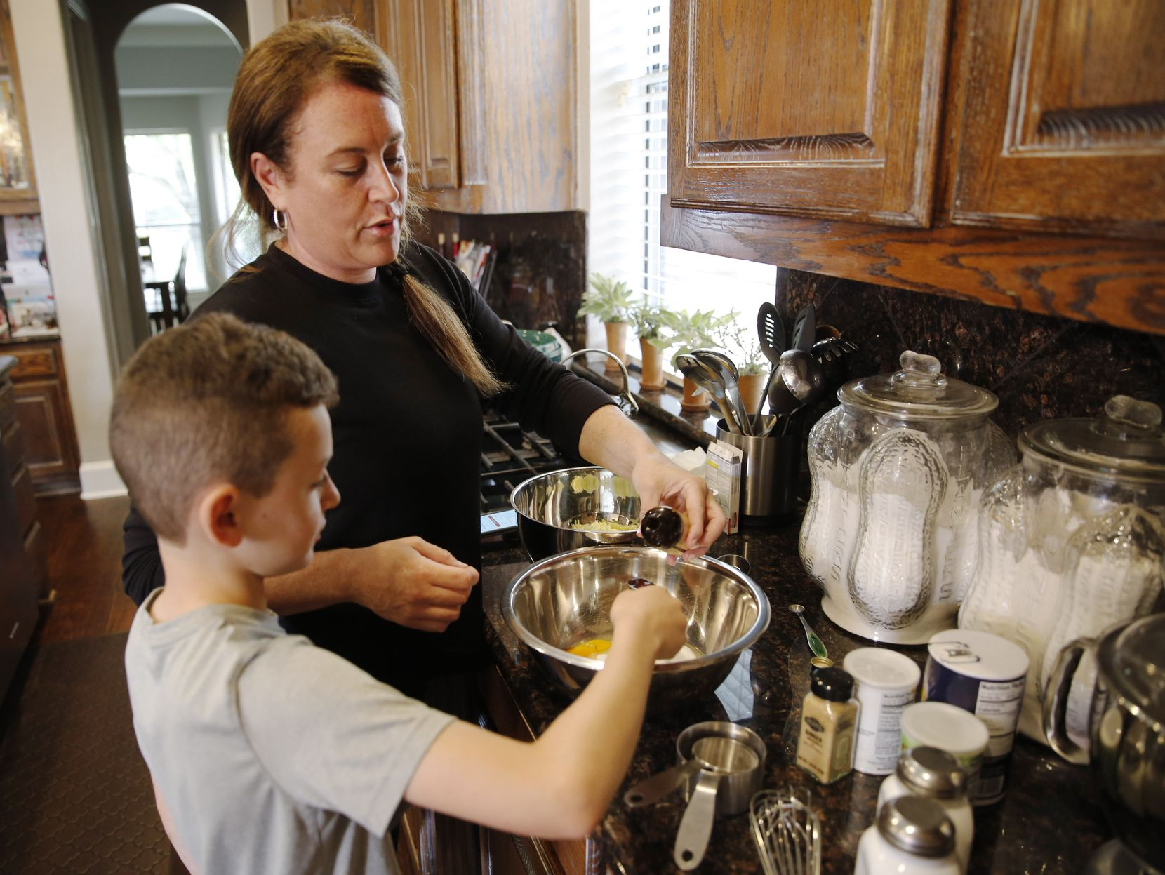 Frisco resident Jamie Heit and her son Brandon cooked together at their home in the early days of the pandemic after schools across North Texas went virtual.