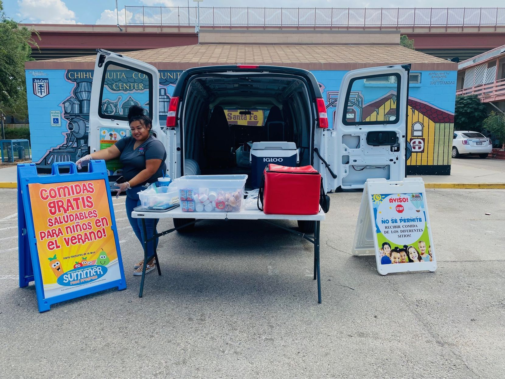 Rebecca Hernandez prepares to provide after school lunch to children in Chihuahuita, a neighborhood in El Paso that parallels border fence and a new toll road.