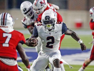 Allen High School running back Jaylen Jenkins (2) makes a move before getting past McKinney Boyd High School defensive back Peyton Shaw (7) for the game's first touchdown during the first half as McKinney Boyd High School hosted Allen High School at McKinney I.S.D. Stadium on Friday, October 1, 2021. (Stewart F. House/Special Contributor)