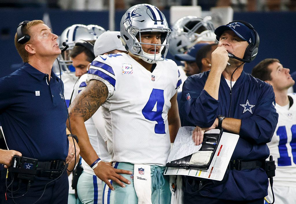 Dallas Cowboys head coach Jason Garrett, quarterback Dak Prescott (4), and offensive coordinator Scott Linehan wait for a replay review of fourth-and-one play a during the second half of an NFL football game against the Green Bay Packers at AT&T Stadium on Sunday, Oct. 8, 2017, in Arlington, Texas. The Packers won the game 35-31. (Smiley N. Pool/The Dallas Morning News)