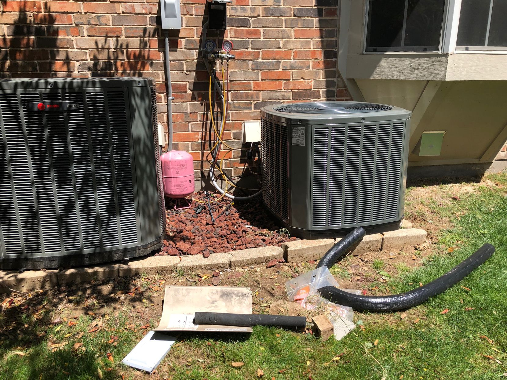 Watchdog Dave Lieber took this photo of the conversion of his home's air conditioning unit from the old refrigerant to the new, more environmentally friendly one. The manufacturing of R-22 Freon comes to a halt in January due to a federal mandate.