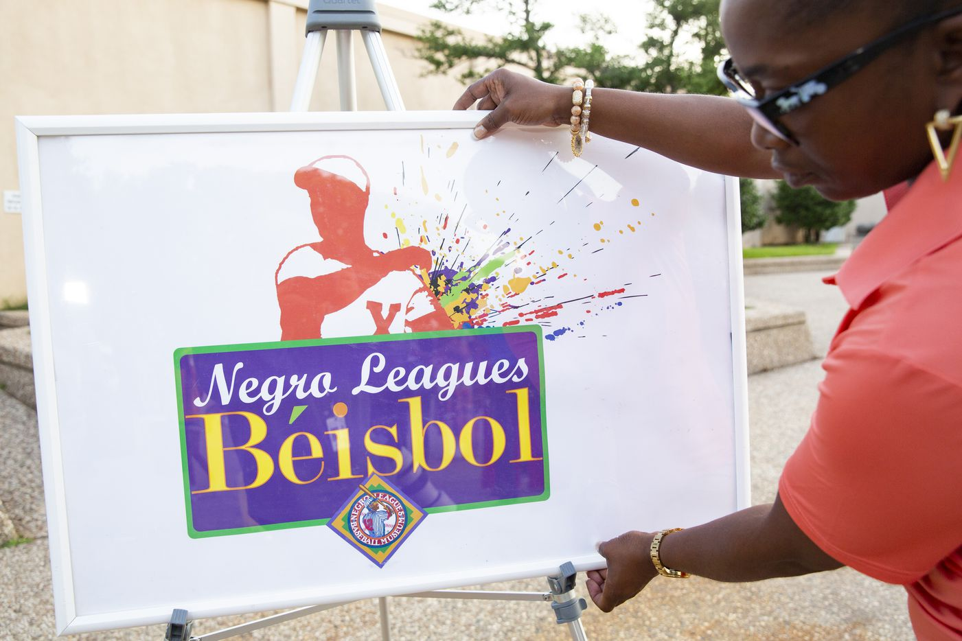 Sherry Blair puts up a sign from the Negro League Baseball exhibit on Friday, June 18, 2021, during a media preview at Fair Park in Dallas. The exhibit opens Saturday as part of the Juneteenth Celebration in Fair Park. (Juan Figueroa/The Dallas Morning News)