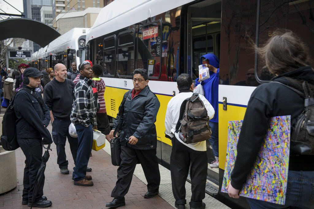 Commuters board the DART train in downtown Dallas.