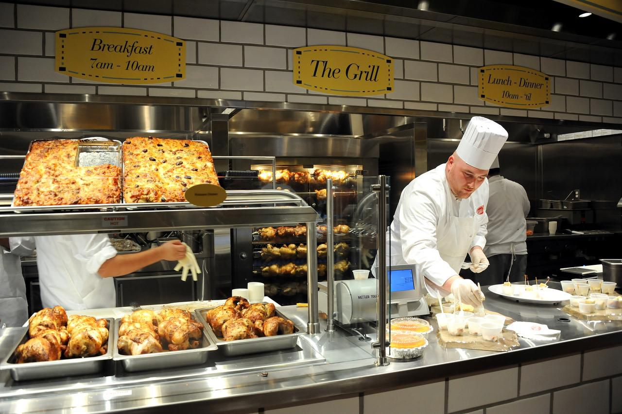 Chef at The Grill, Robert Levin, prepares macaroni and cheese, corn bread, and rotisserie chicken for customers to taste at the new location of Eatzi's in Plano, TX officially opening on September 20, 2013. (Alexandra Olivia/ Special Contributor)