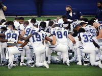 At the end of warmups, the Dallas Cowboys football gathered around and took a knee before exiting the field at AT&T Stadium in Arlington, Thursday, November 26, 2020. The Cowboys were facing the Washington Football Team in the wake of Cowboys strength coach Markus Paul's death.