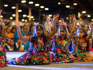 Children in dance teams perform onstage during Diwali Mela at Fair Park in 2016. This year's celebrations around the world will be greatly pared back due to the ongoing coronavirus pandemic.