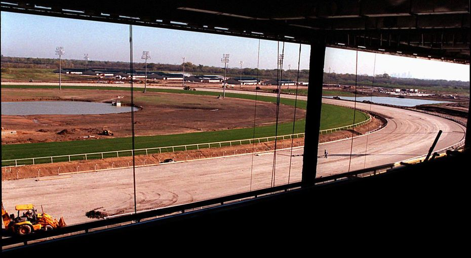 The horse barns can be seen in the distance from the third level of the grandstand where the box seats are located at Lone Star Park in Grand Prairie on Nov. 26, 1996.
