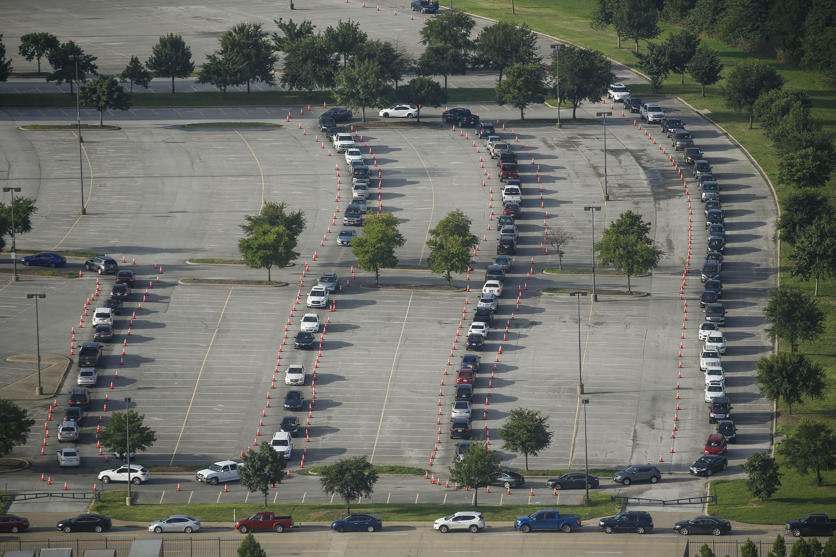Hundreds of cars weaved around Ellis Davis Field House in the Red Bird area of southern Dallas on June 26 as residents waited to be tested for COVID-19. Since the pandemic began, several area locations have offered free screening for the virus.