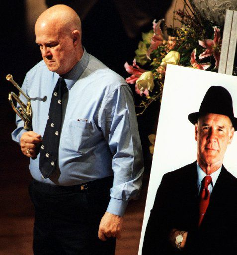 Trumpet player Tommy Loy paused for a moment before the memorial service for legendary Cowboys coach Tom Landry in 2000 at the Meyerson Symphony Center.