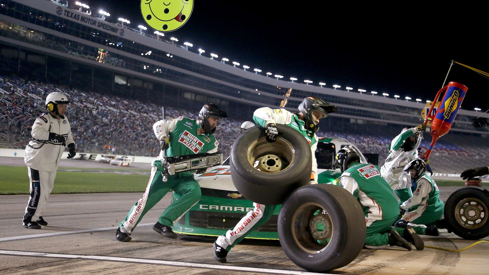Pit crew members for Kevin Harvick in the #5 Hunt Brothers Pizza Chevrolet during a pit stop in the Nascar 18th Annual O'Reilly Auto Parts 300 at Texas Motor Speedway in Fort Worth, Texas on Friday, April 4, 2014.