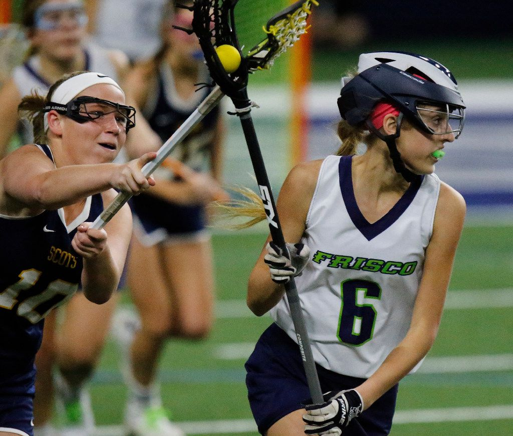 Frisco's Haley Donovan (6) looks to make a pass while Highland Park's Kennedy Cox (10) tries to force a turnover during the first half as Highland Park played the Frisco Fury as part of the Patriot Cup lacrosse tournament at The Ford Center at The Star in Frisco on Saturday, February 18, 2017. (Stewart F. House/Special Contributor)