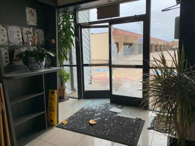 A glass door was smashed at Banh Cuon Thang Long restaurant in Garland.
